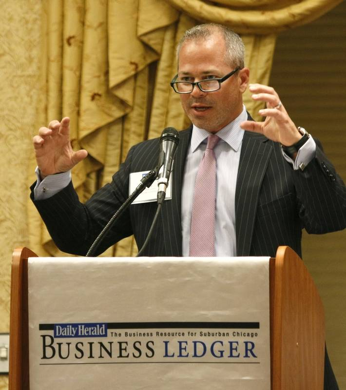 "Jeff Krusinski, president of Krusinski Construction, Thursday addresses the Newsmakers' Forum, ""Managing A Family Business"" at the Hilton Hotel in Lisle."