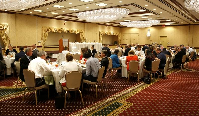 "Around 65 people enjoy lunch Thursday during the Newsmakers' Forum ""Managing A Family Business"" at the Hilton Hotel in Lisle."