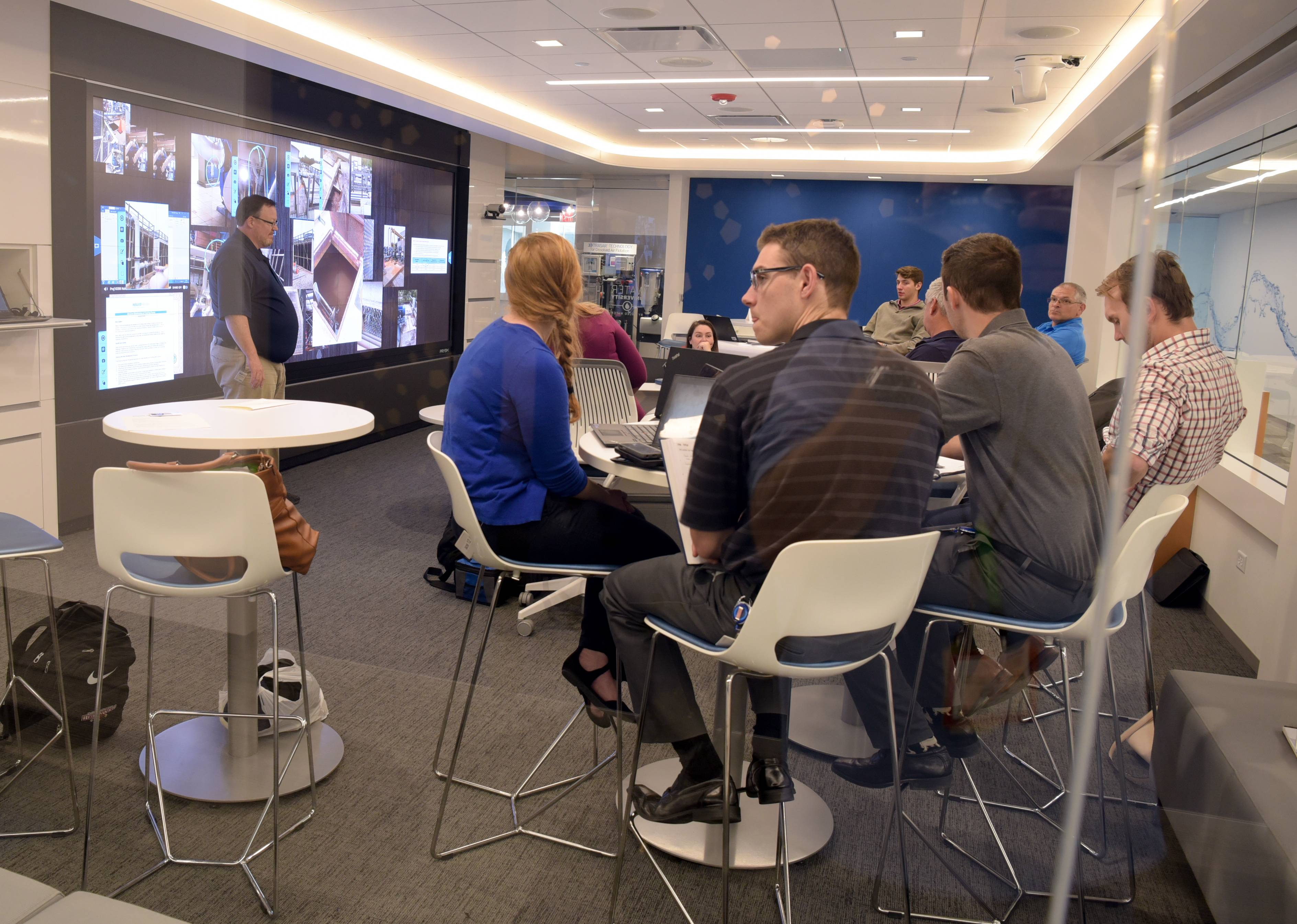 One of the interactive learning centers in the new Water University at the Nalco Water/Ecolab campus in Naperville features a multimedia wall and group seating.