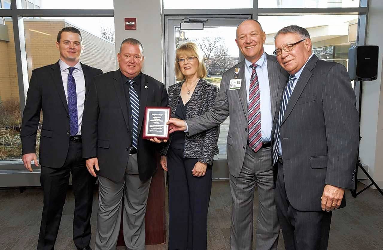 From left, Joseph Quinn and Jim Meier, Harper College Educational Foundation Board; Diane Hill, Harper College trustee and chair of the Northwest Community Healthcare Board of Directors; Stephen Scogna, NCH president and CEO; and Ken Ender, Harper College president, recognize NCH as a longtime employer of Harper alumni.