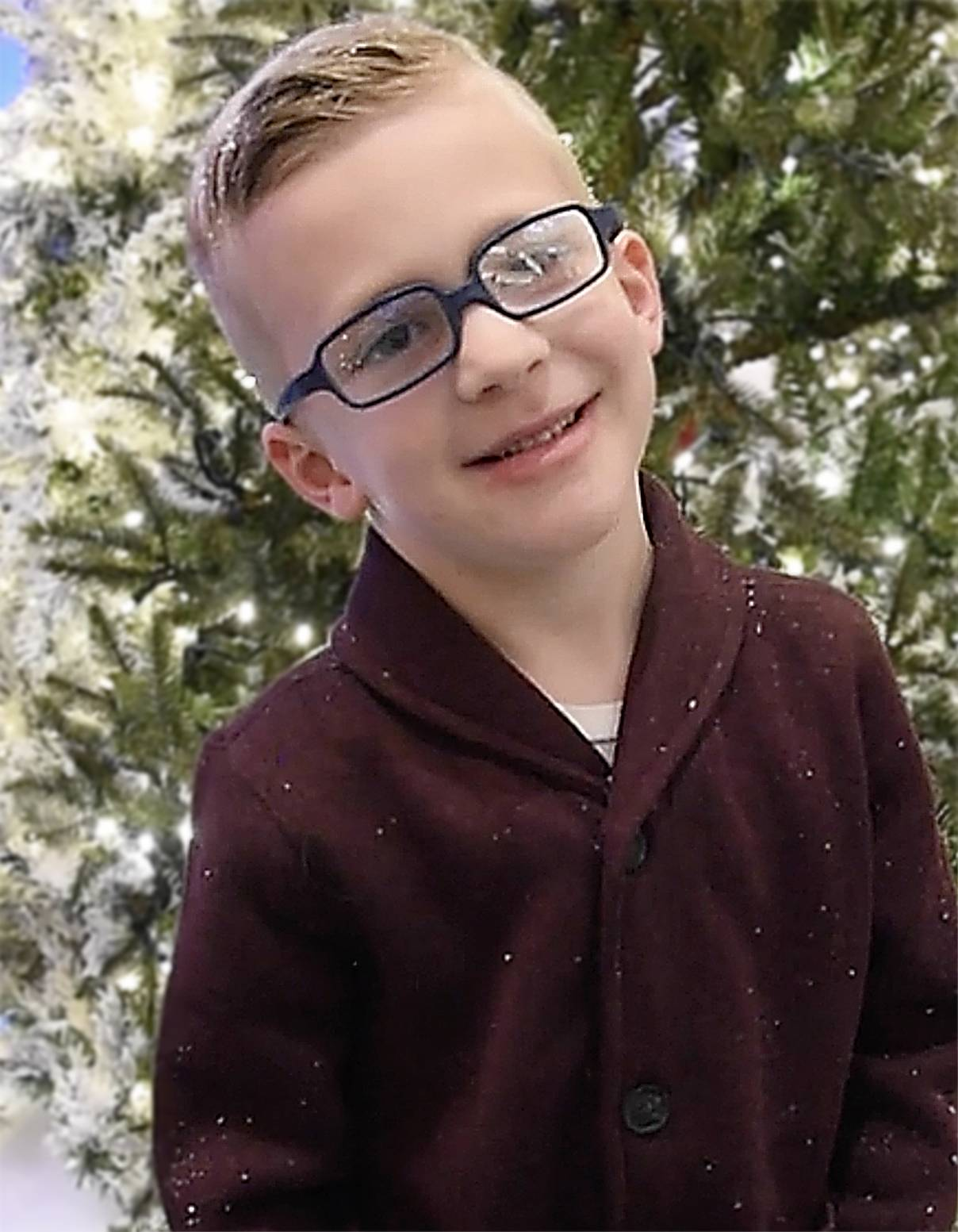 "Joshua Lanners, 5, of Carol Stream had a very specific request for ""a golden rock that's shiny and it has mounted diamonds with a circle under it."" He was among kids who lined up to tell Santa Claus their wishes at the Woodfield Mall in Schaumburg."