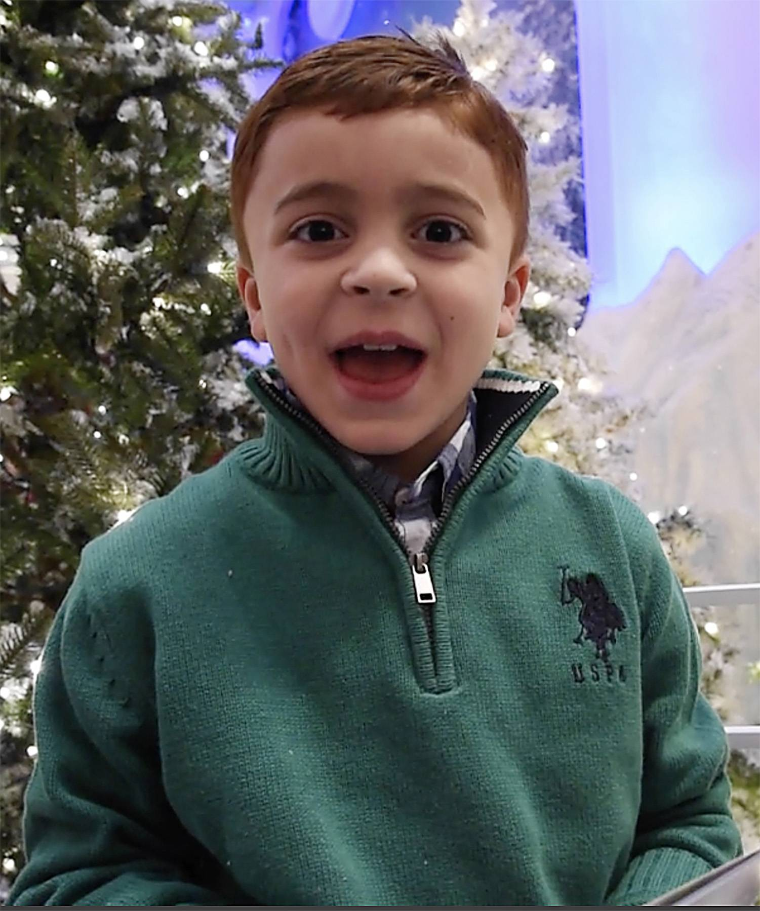 "Klevis Cela, 7, who was visiting from Albania, requested ""a drone with a camera"" as he visited with Santa Claus at the Woodfield Mall in Schaumburg. He added that he wanted it to be red and green."