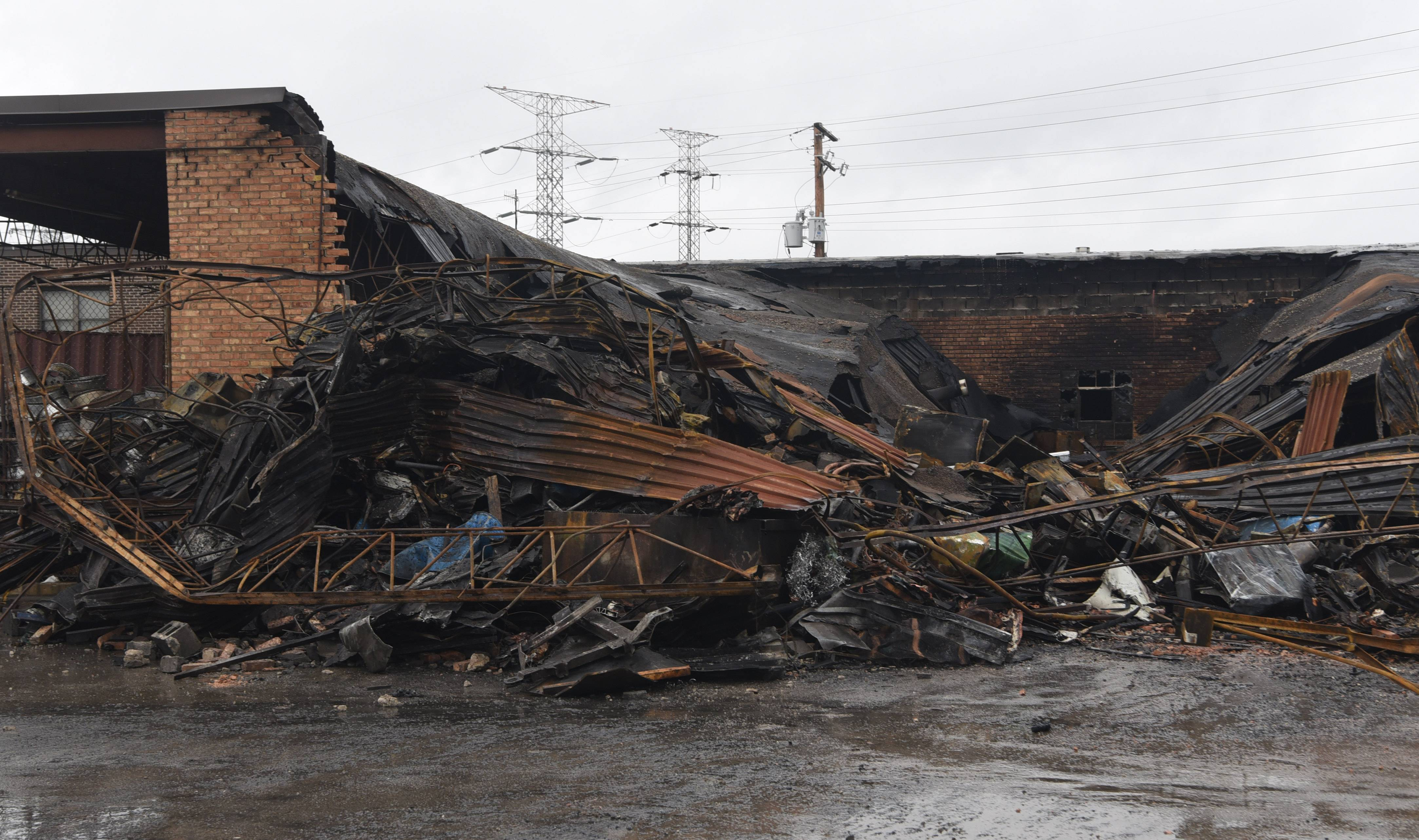The rear 10,000-square-foot portion of a scrap metal recycling facility was destroyed by an overnight fire Thursday in Des Plaines.