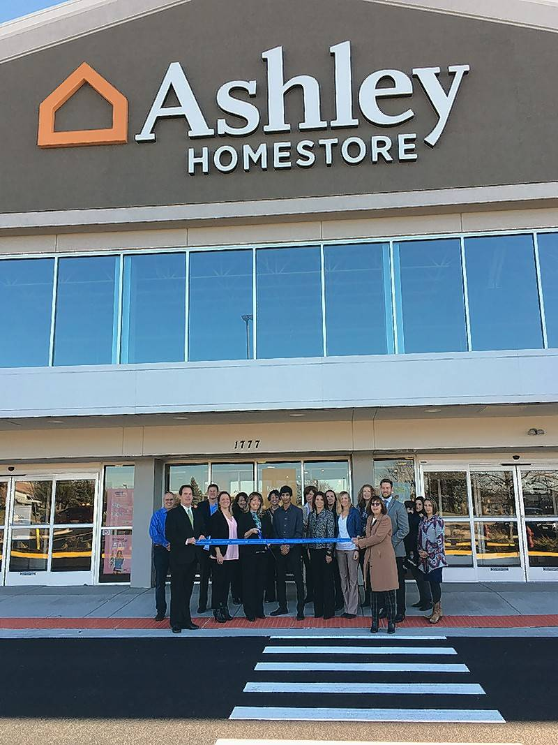The Geneva Chamber of Commerce held a ribbon cutting for Ashley HomeStore, 1777 S. Randall Road in Geneva.   Geneva Mayor Kevin Burns and Geneva Chamber of Commerce Membership Director Judy Carroll hold the ribbon while Store Manager Jennifer Rocha cuts the ribbon surrounded by employees, city officials and chamber board members.