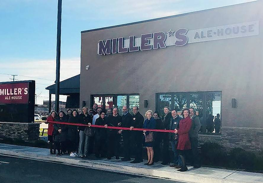 The Schaumburg Business Association held a ribbon cutting at Miller's Ale House, 1300 N. Meacham Road. Village Clerk Marilyn Karr, Trustee George Dunham, and Trustee Diane Dunham are among the guests in attendance.
