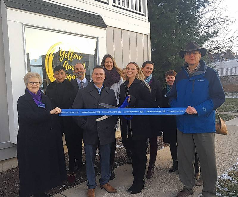 The Geneva Chamber of Commerce held a ribbon cutting for Yellow Aura Yoga, 27 N. Second St., Unit 101, Geneva. Geneva Chamber of Commerce President Jean Gaines and Geneva Chamber of Commerce Board Member Neil Johnson held the ribbon while owner Heather Kellogg cut the ribbon.