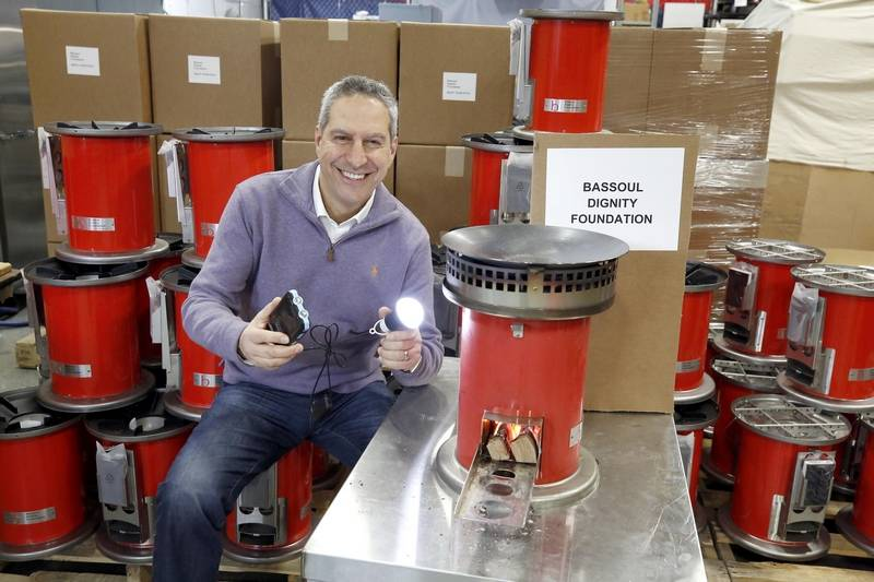 Selim Bassoul, CEO at Middleby in Elgin is surrounded by some of the ovens that he is sending to Haiti and Puerto Rico.