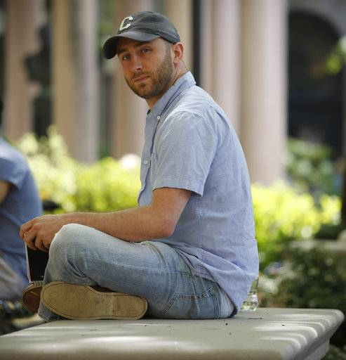 In this May 9, 2018 photo, Iraq War veteran Kristofer Goldsmith poses for a photo at a campus park after his last final exam of the semester at Columbia University in New York. Military veterans with less-than-honorable discharges from the military say they often can't get jobs, and they hope a recent warning to employers by the state of Connecticut will change that. Goldsmith says that for veterans with bad paper, their service record looks more like a criminal record to potential employers. (AP Photo/Bebeto Matthews)