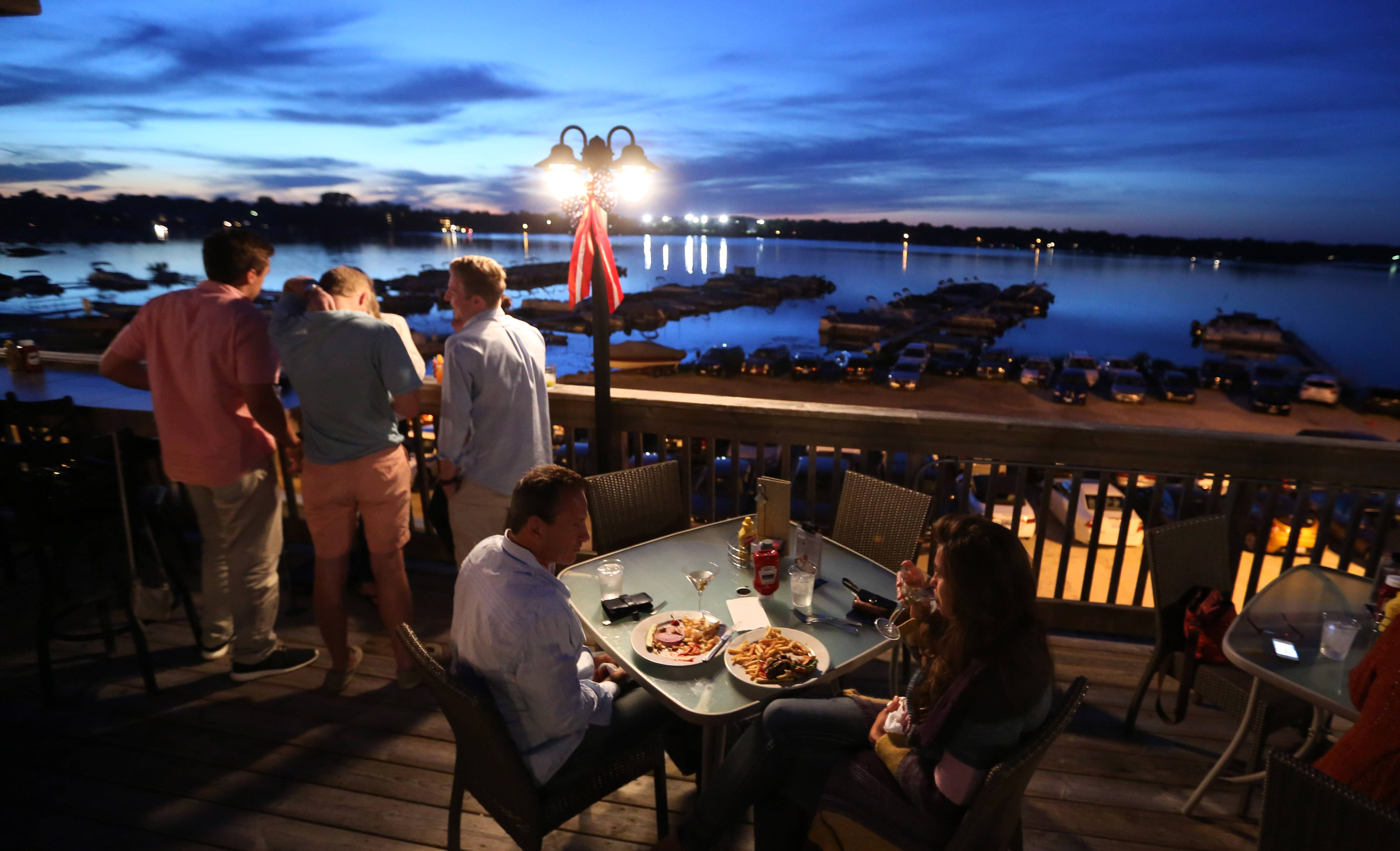 The outdoor dining and bar area at Docks Bar and Grill overlooks Bangs Lake in Wauconda.