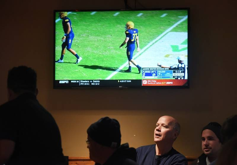 Elk Grove Village public works employee John Wesa is among those watching the village-sponsored Makers Wanted Bahamas Bowl during Friday's viewing party at Real Time Sports.