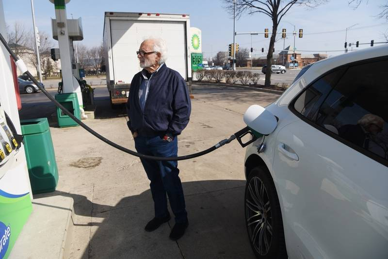 John Giandonato of Schaumburg fuels his car Thursday at the BP station at the corner of Golf and Meacham roads in Schaumburg, where regular unleaded was priced at $3.09 a gallon.