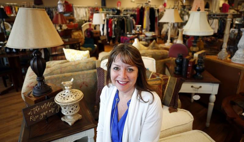 Teri Case is the owner of Boutique Repeats & Gifts in Aurora. The upscale consignment store has grown in scale and popularity as people seek help in uncluttering their lives.  Some of the jewelry for sale, left, and a Louis Vuitton purse, above.