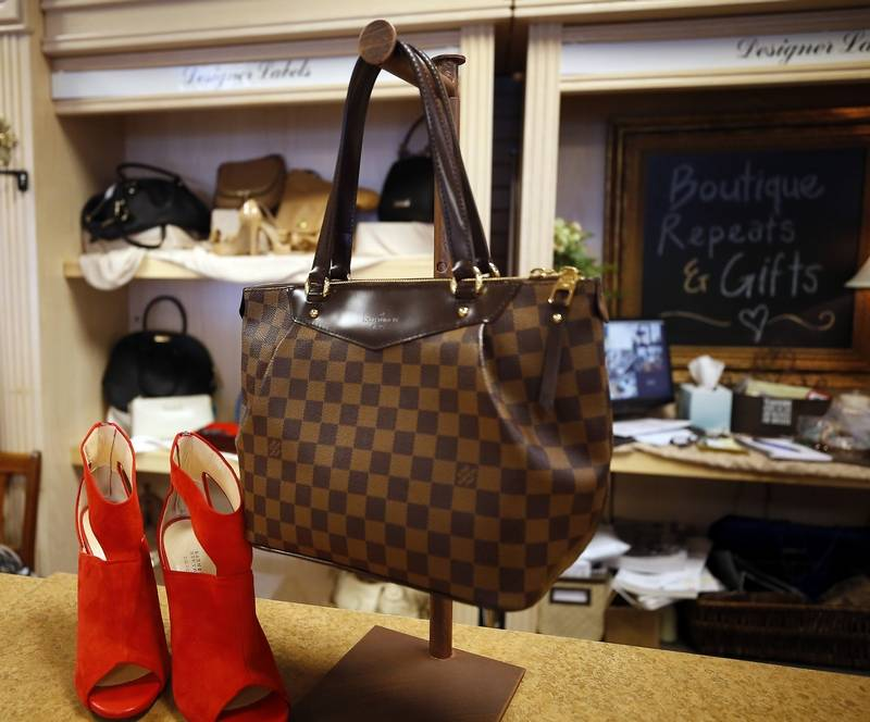 Brian Hill/bhill@dailyherald.comA Louis Vuitton purse for sale at Boutique Repeats & Gifts in Aurora.