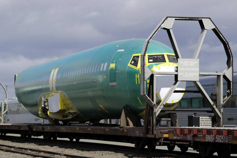 AP FILE PHOTOA Boeing 737 fuselage, eventually bound for Boeing's production facility in nearby Renton, Wash., sits on a flatcar rail car at a rail yard in Seattle. The Chicago-based company is pulling its 2019 forecast over 737 Max uncertainty and says it's suspending its stock buybacks.