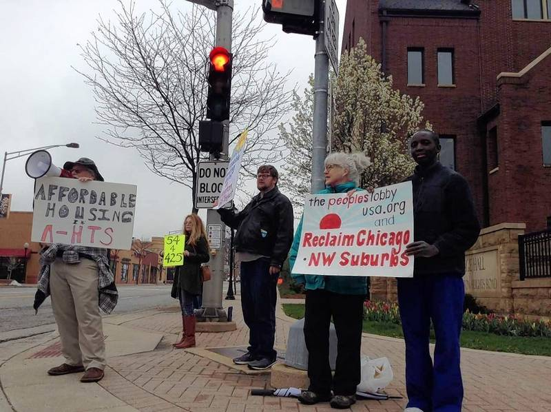 Advocates pushing for more affordable units in the Arlington 425 development held a protest Monday night outside Arlington Heights village hall, where the housing commission later met to discuss the proposal.