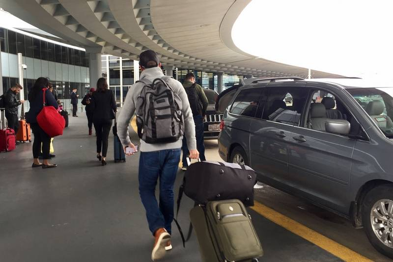 Travelers connect with Uber and Lyft drivers Wednesday at O'Hare. Several customers said they empathized on a global day of protest by ride-hailing workers who are frustrated with hours and wages.