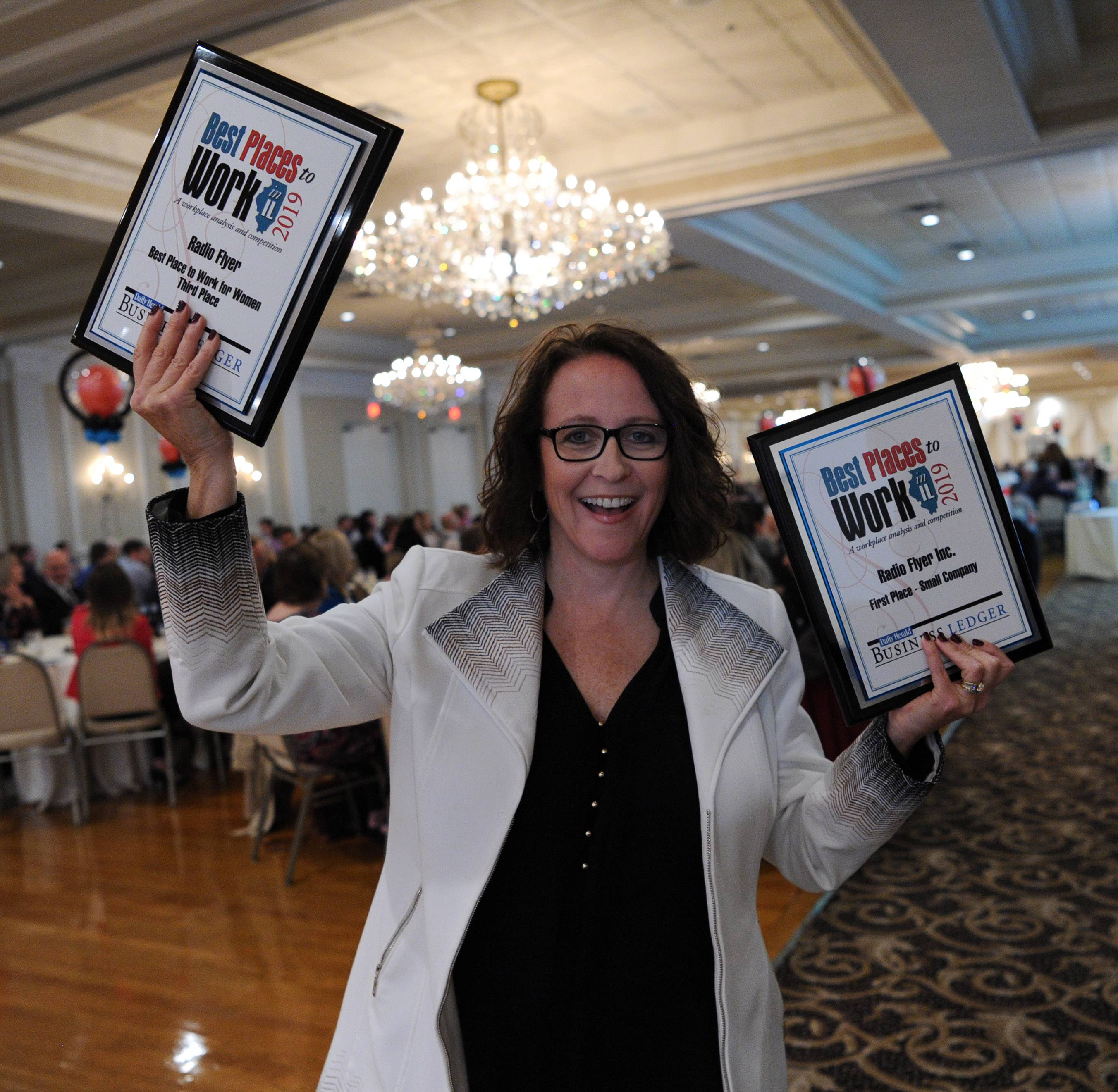 Amy Bastuga, chief people officer of Radio Flyer in Chicago, celebrates winning first in the Small Company division at the Best Places to Work in Illinois awards ceremony. The company also took third in a new category, Best Places to Work for Women.