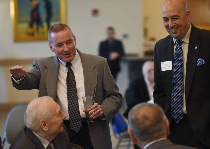 Elk Grove Village leader Craig Johnson, left, and business partner Bill Beaupre of Johnson Insurance Agency visit with village board members before the mayor's 2019 State of the Village Address on Thursday at Belvedere Banquets.