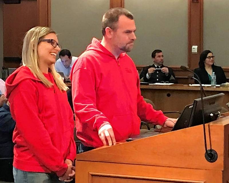 Mount Prospect residents Marci and Will Lehnert tell the village board about their plan to open a hot dog restaurant in downtown called Hubby's in the Dog House.