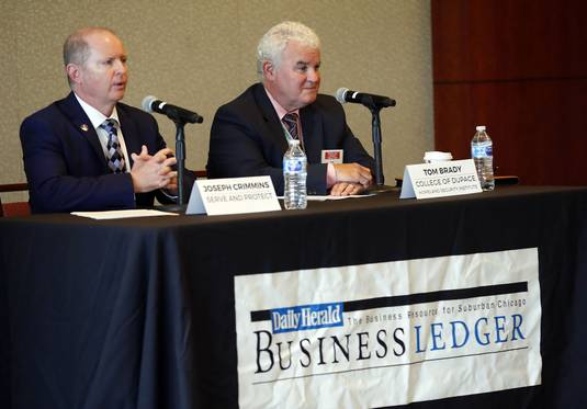 Panelists Joseph Crimmins of Serve and Protect, left, and Tom Brady of the Homeland Security Training Institute at College of DuPage at the Daily Herald Business Ledger's Violence in the Workplace forum at Eaglewood Resort & Spa in Itasca on Thursday.