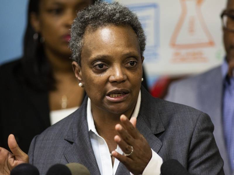 Mayor Lori Lightfoot speaks to reporters Monday after visiting Chicago Public Schools students at a contingency site, James R. Jordan Boys & Girls Club in Chicago.