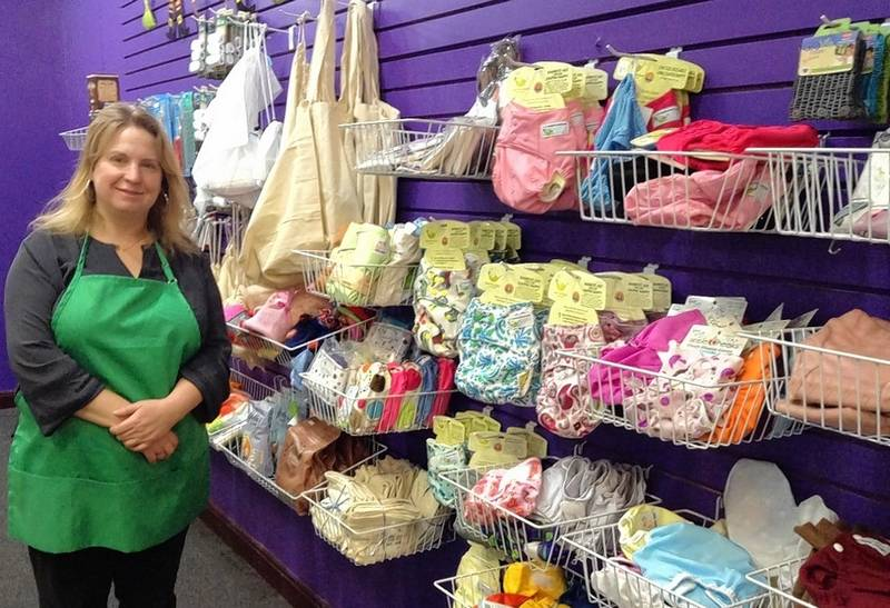 Mary Stupen of Palatine shows off some of the environmentally friendly products, including cloth diapers, that are also part of her new Purple Me Green, The Science Store location at Woodfield Mall in Schaumburg.