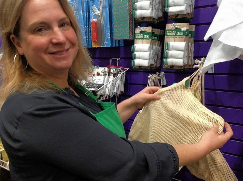 Mary Stupen of Palatine shows various environmentally friendly products at her new Purple Me Green, The Science Store location at Woodfield Mall in Schaumburg, including a cloth produce sack that allows gases to escape and the fruit and vegetables within to last longer.