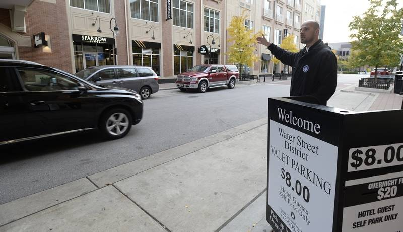 Jim Shanchuk, president of Silver Crown Valet in Naperville, said he's concerned about how to enforce drug-free policies at work after recreational marijuana becomes legal Jan 1. Here, he's pictured working on Water Street in Naperville.