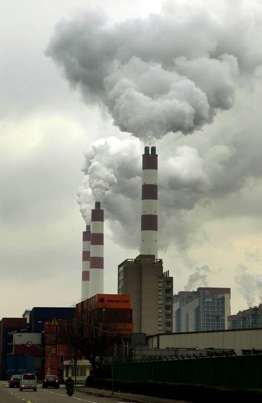 Factory chimneys pour out smoke in Shanghai in 2009, but China has made progress after declaring war on pollution in 2014.