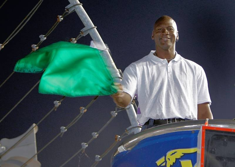 Michael Jordan might like to practice waving the green flag, and he'll remain a fan of NASCAR but not an owner, he said.