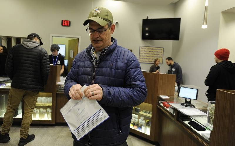 Marc Steinberg of Vernon Hills picks up his vape pen from the cannabis store Rise in Mundelein.