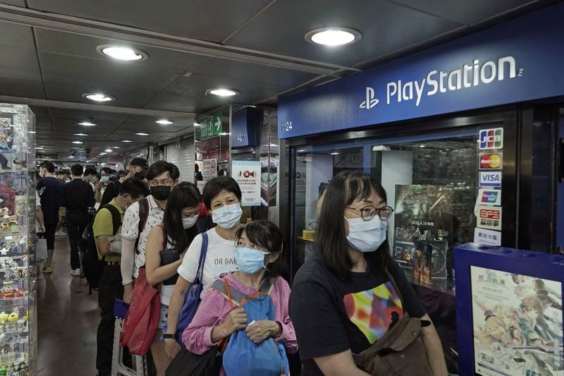 Gaming enthusiasts queue up for the pre-order sales of the newly unveiled Japanese brand video game console, Sony's PlayStation 5 (PS5), outside a retailer in Hong Kong, Friday, Sept. 18, 2020. Preorders of PlayStation 5 started on Sept. 17.